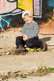 Introvert little boy sitting thinking Stock Images