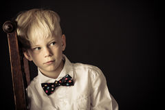 Introvert withdrawn little blond boy royalty free stock photo