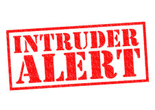INTRUDER ALERT. Red Rubber Stamp over a white background Royalty Free Stock Images