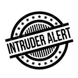 Intruder Alert rubber stamp. Grunge design with dust scratches. Effects can be easily removed for a clean, crisp look. Color is easily changed Stock Photography