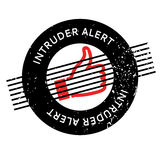 Intruder Alert rubber stamp. Grunge design with dust scratches. Effects can be easily removed for a clean, crisp look. Color is easily changed Stock Images