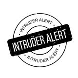 Intruder Alert rubber stamp. Grunge design with dust scratches. Effects can be easily removed for a clean, crisp look. Color is easily changed Royalty Free Stock Photo