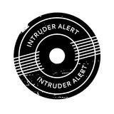 Intruder Alert rubber stamp. Grunge design with dust scratches. Effects can be easily removed for a clean, crisp look. Color is easily changed Stock Photo