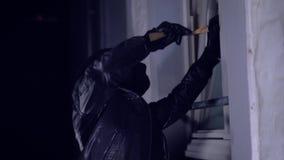 Intruder or burglar with crowbar