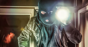 Intruder or burglar with crowbar Royalty Free Stock Images