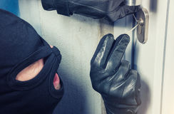 Intruder or burglar with lock picking tools Royalty Free Stock Images