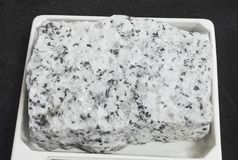 Biotite granite intrusive igneous rocks. Intrusive igneous rocks. Geological collection in Colombia for geologists. Study of soils, minerals and rocks. Sample Royalty Free Stock Images