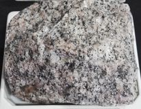 Biotite granite coarse Intrusive igneous rocks. Intrusive igneous rocks. Geological collection in Colombia for geologists. Study of soils, minerals and rocks Stock Photos