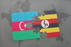 intryguje z flaga państowowa Azerbaijan i Uganda na światowej mapie Fotografia Stock