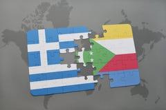 intryguje z flaga państowowa Greece i Comoros na światowej mapy tle Obrazy Stock