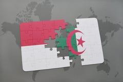 intryguje z flaga państowowa Indonesia i Algeria na światowej mapy tle Zdjęcia Stock