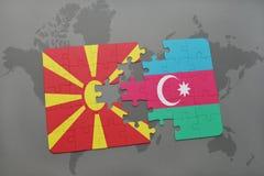 intryguje z flaga państowowa Macedonia i Azerbaijan na światowej mapy tle Zdjęcie Stock