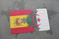 intryguje z flaga państowowa Spain i Algeria na światowej mapy tle Fotografia Royalty Free