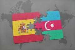 intryguje z flaga państowowa Spain i Azerbaijan na światowej mapy tle Zdjęcie Stock