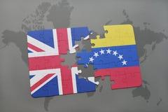 intryguje z flaga państowowa wielki Britain i Venezuela na światowej mapy tle Fotografia Royalty Free