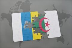 intryguje z flaga państowowa wyspy kanaryjska i Algeria na światowej mapy tle Obraz Stock