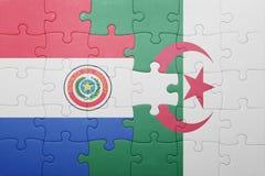 intryguje z flaga państowowa Algeria i Paraguay Zdjęcie Royalty Free