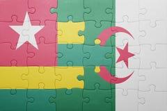 intryguje z flaga państowowa Algeria i Togo Obrazy Royalty Free