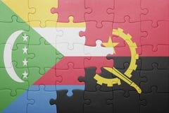 intryguje z flaga państowowa Angola i Comoros Obraz Royalty Free