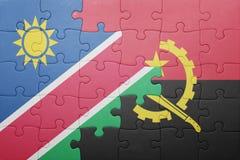 intryguje z flaga państowowa Angola i Namibia Fotografia Stock