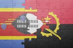 intryguje z flaga państowowa Angola i Swaziland Fotografia Royalty Free