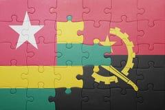 intryguje z flaga państowowa Angola i Togo Obraz Royalty Free