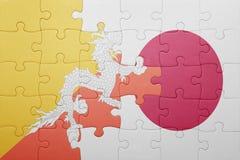 Intryguje z flaga państowowa Bhutan i Japan Zdjęcie Royalty Free