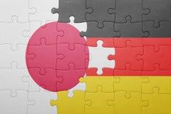 Intryguje z flaga państowowa Germany i Japan Obraz Royalty Free