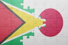 Intryguje z flaga państowowa Guyana i Japan Zdjęcie Royalty Free