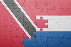 Intryguje z flaga państowowa holandie, Trinidad i Tobago Zdjęcia Stock