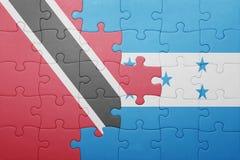 Intryguje z flaga państowowa Honduras, Trinidad i Tobago Zdjęcia Stock