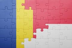 Intryguje z flaga państowowa Indonesia i Romania Zdjęcia Stock
