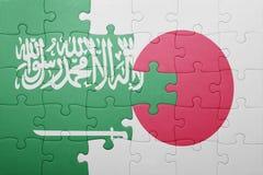 Intryguje z flaga państowowa Japan Arabia i saudyjczyk Fotografia Royalty Free