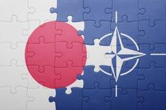 Intryguje z flaga państowowa Japan i nato Obraz Stock