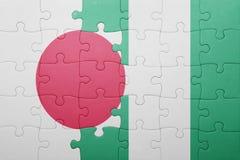 intryguje z flaga państowowa Japan i Nigeria Obraz Royalty Free
