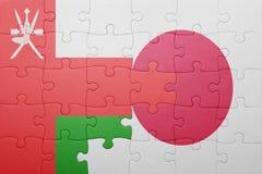 Intryguje z flaga państowowa Japan i Oman Obrazy Royalty Free