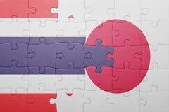 Intryguje z flaga państowowa Japan i Thailand Zdjęcia Royalty Free