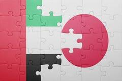 Intryguje z flaga państowowa Japan i zlani arabscy emiraty Obraz Royalty Free