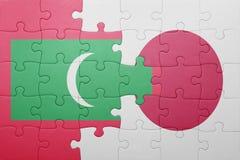 Intryguje z flaga państowowa Maldives i Japan Zdjęcia Royalty Free