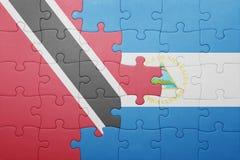Intryguje z flaga państowowa Nicaragua, Trinidad i Tobago Obraz Stock