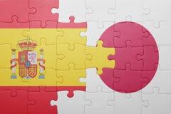 Intryguje z flaga państowowa Spain i Japan Obrazy Stock
