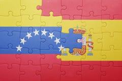 Intryguje z flaga państowowa Spain i Venezuela Zdjęcie Royalty Free