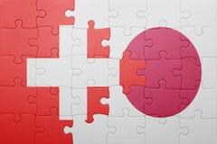Intryguje z flaga państowowa Switzerland i Japan Fotografia Stock