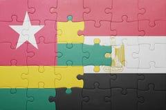 intryguje z flaga państowowa Togo i Egypt Zdjęcie Royalty Free