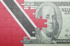 Intryguje z flaga państowowa Trinidad, Tobago i dolarowy banknot Zdjęcie Royalty Free