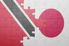Intryguje z flaga państowowa Trinidad, Tobago i Japan Fotografia Stock