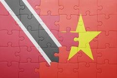 intryguje z flaga państowowa Trinidad, Tobago i Vietnam Zdjęcia Stock
