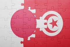 intryguje z flaga państowowa Tunisia i Japan Obrazy Royalty Free