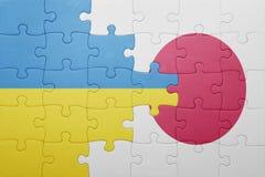 Intryguje z flaga państowowa Ukraine i Japan Obrazy Stock