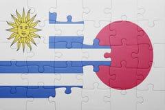 Intryguje z flaga państowowa Uruguay i Japan Zdjęcia Royalty Free